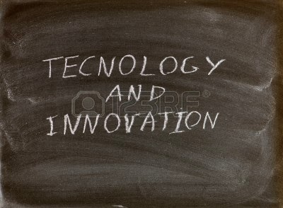 the words technology and innovation written on a blackboard