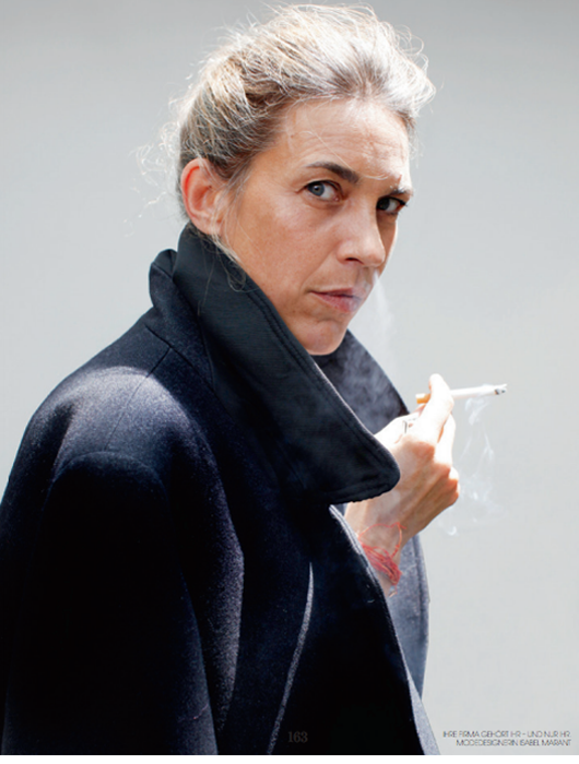 Isabel Marant smoking a cigarette (or weed)