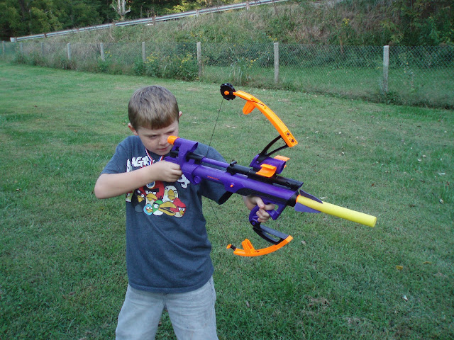 Comic Book Boy shooting Nerf toy bow