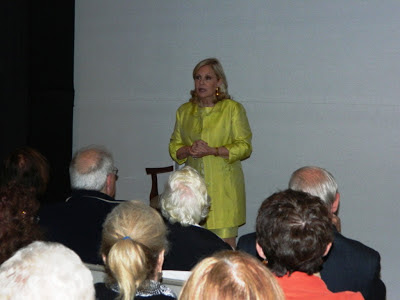 "Tina Sloan entertains the audience at the Athertyn Residents' Clubhouse with her presentation of ""Changing Shoes"""