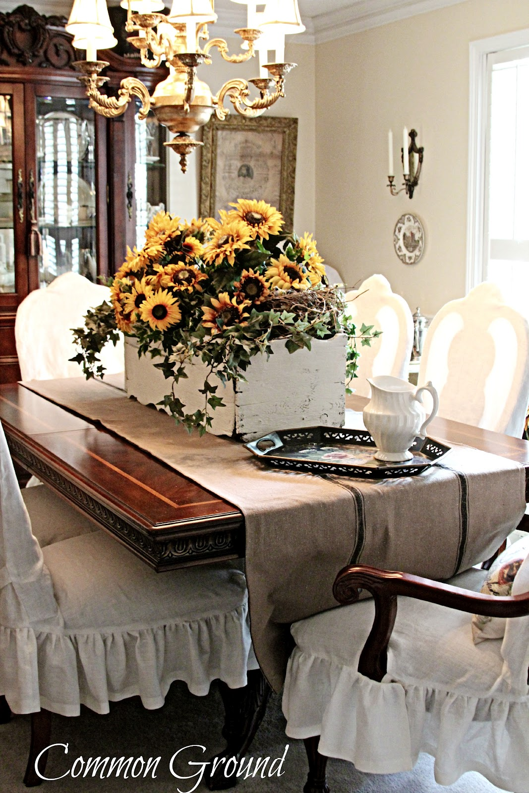 Common ground sunflowers Formal dining table centerpiece ideas