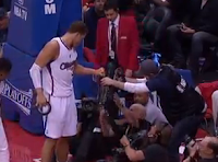 Blake Griffin tangled up in camera row