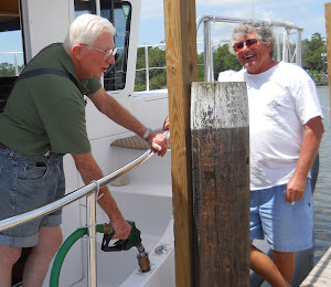Fred and Richard chat while the diesel runs quickly thru our new adapter.  Dog River, AL