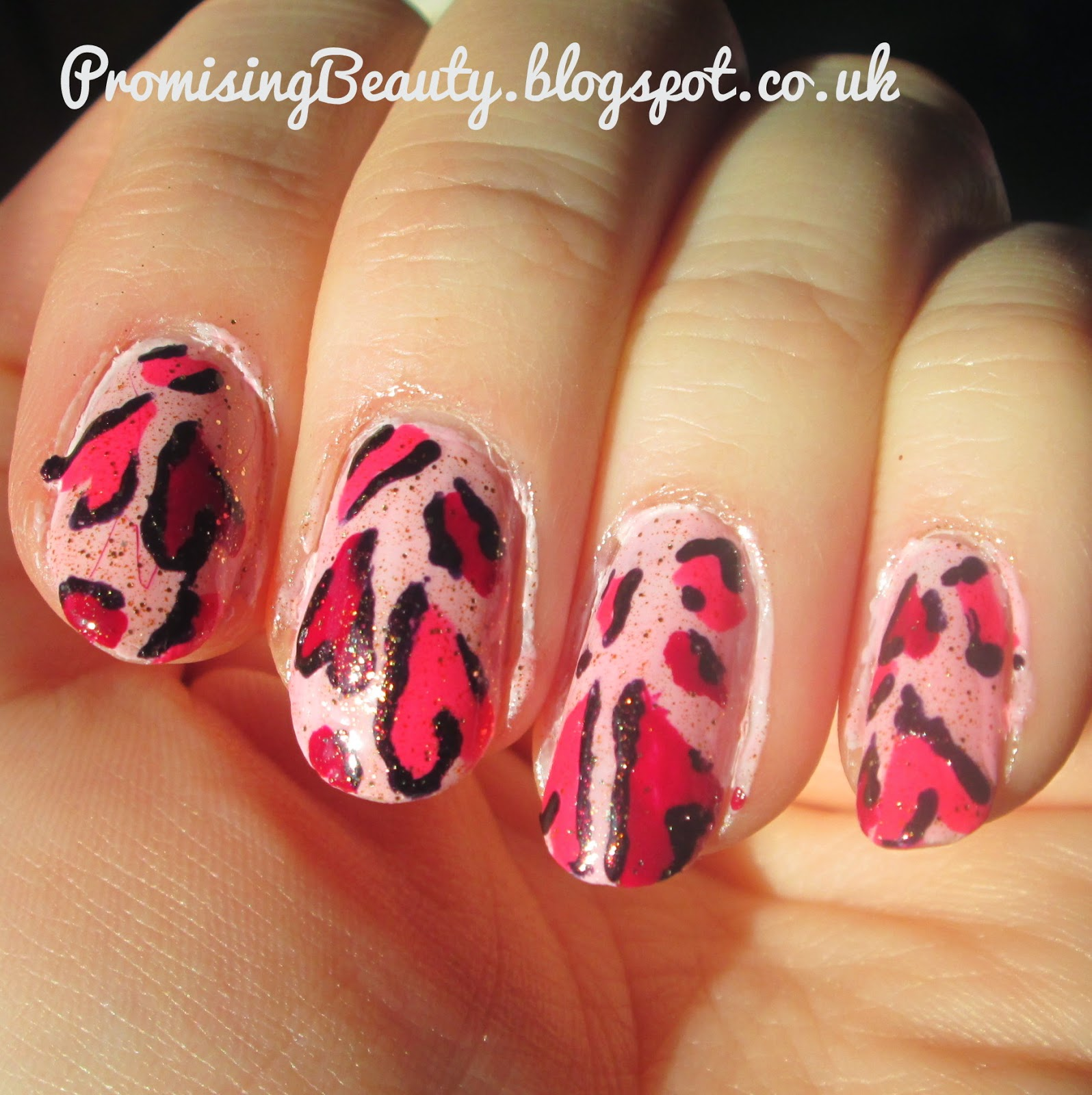 Valentine's day nails. Pink leopard print hearts manicure. Nail art red, plum, pink and glitter
