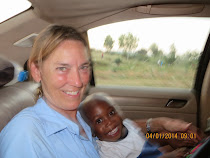 "Valerie M and Anotidalshe Chiweshe (""God Is With Us"") on road to Masvingo, Zimbabwe"