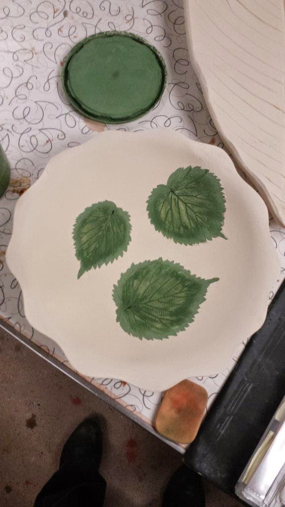 Unique nature-inspired Davidii leaves handmade ceramic pottery stoneware bowl in progress.