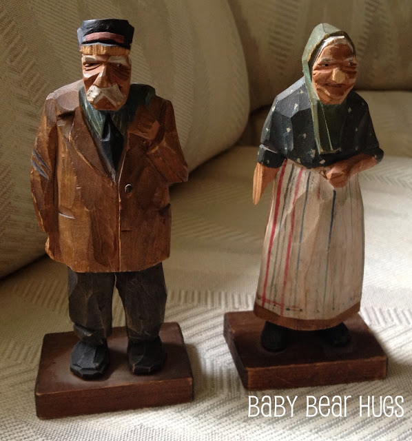 old man and old women wooden figurines