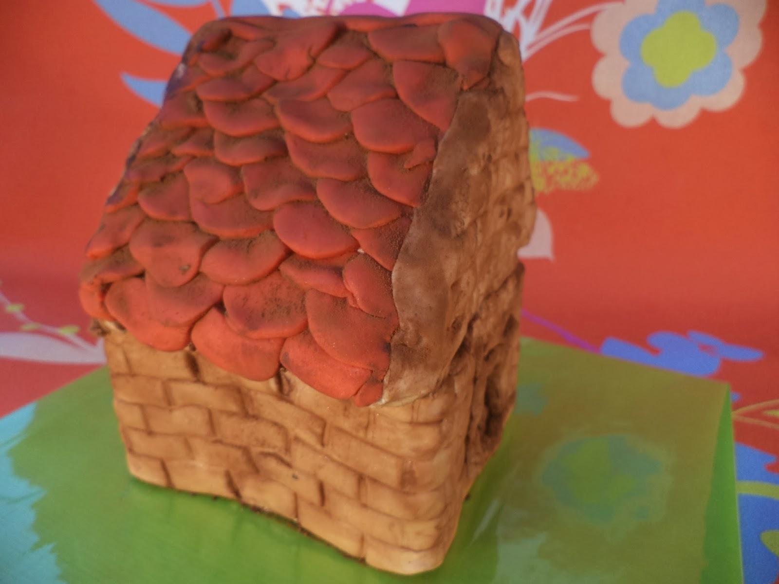 met je kind een huisje maken van cake en fondant
