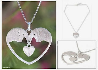 http://unique-gifts.novica.com/womens/animal-lover/sterling-silver-heart-necklace-elephants-in-love/181815/