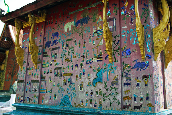 Mosaic on the facade of the red temple shrine Wat Xieng Thong