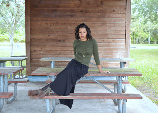 Fashion Blogger Anais Alexandre of Down to Stars in a vintage olive green sweater, black maxi skirt and brown combat boots