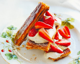 Strawberry and Cream Layer: An elegant dessert of strawberries and cream layered between puff pastry fingers