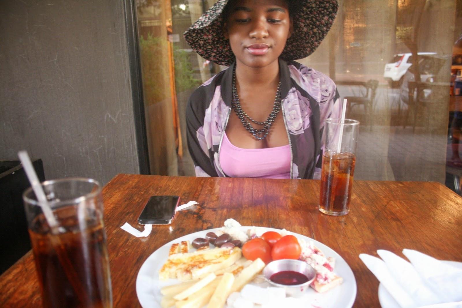 khensani having a cheeseboard and ice tea at pata pata maboneng