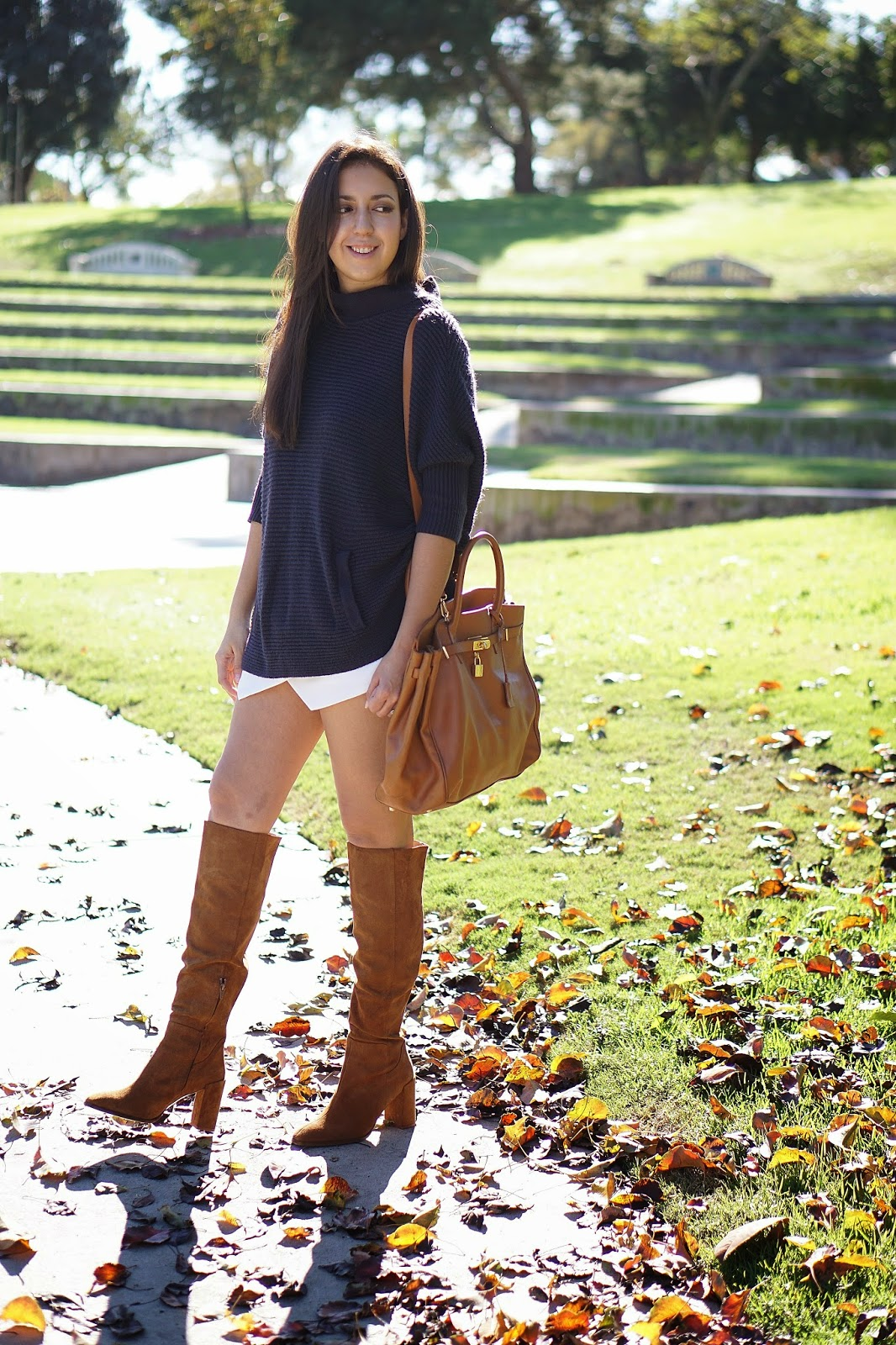 Zara High Heeled Leather Boot, Zara Camel Colored Knee High Boot, Light Brown Boots, Forever 21 White Skort, White Skort, Hermes Inspired Bag, Oversized Navy Sweater, H&M Navy Sweater, How To Wear Knee High Boots With A Skirt