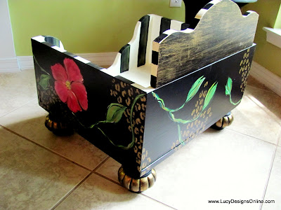 hand painted dog bed with flowers and vines on black
