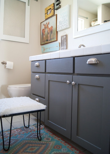Bathroom Makeover - before & after - Zinc cabinet, gallery wall, World Market rug / mat and vintage hairpin leg stool