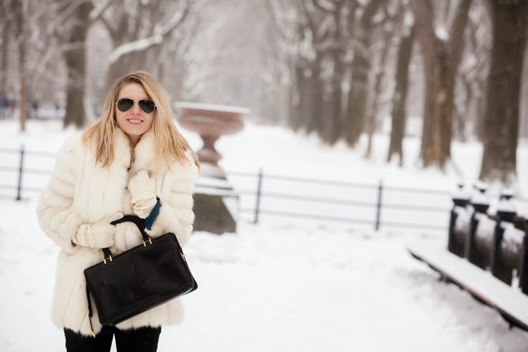 Outerwear, bundling up, wintertime, snowy, white fur, leather bag, ray-ban aviator sunglasses, knit gloves