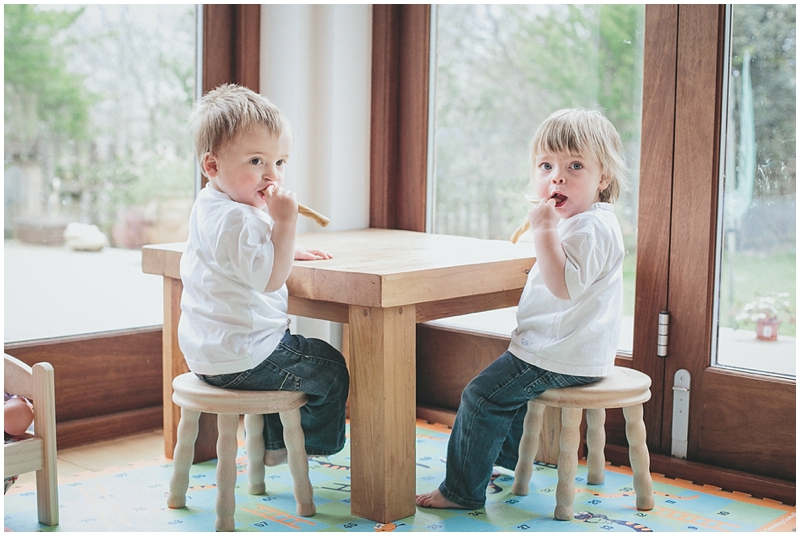 Toddler twins having a snack