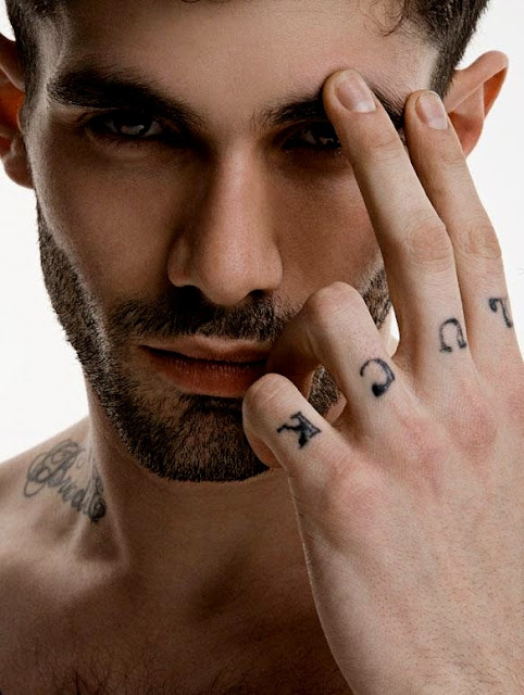 model with luck tattoo fingers