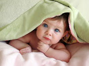 Will you find out the gender of your baby or wait to be surprised the day he . (baby girl under blanket)