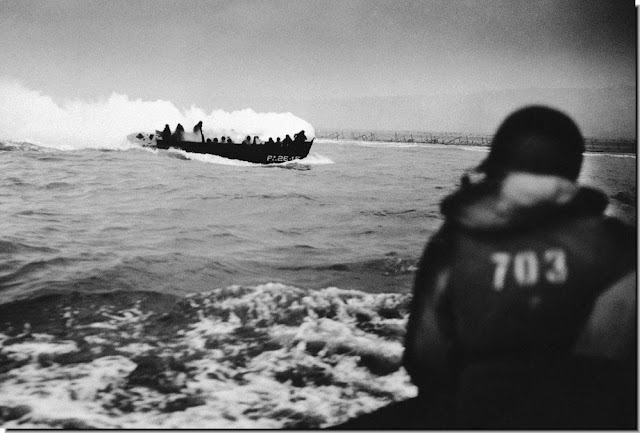 German machine gun fire hits  grenade explodes  landing craft