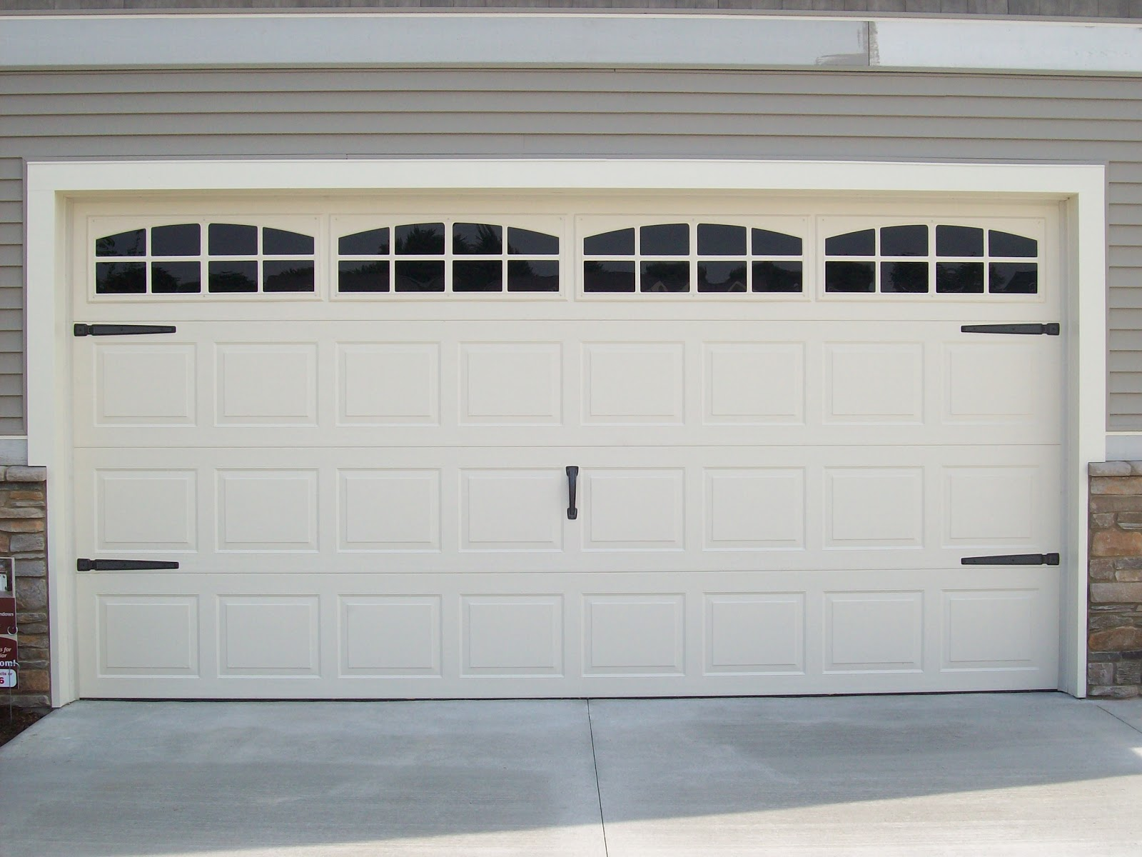 Coach house accents makeover your garage door with coach for Garage doors