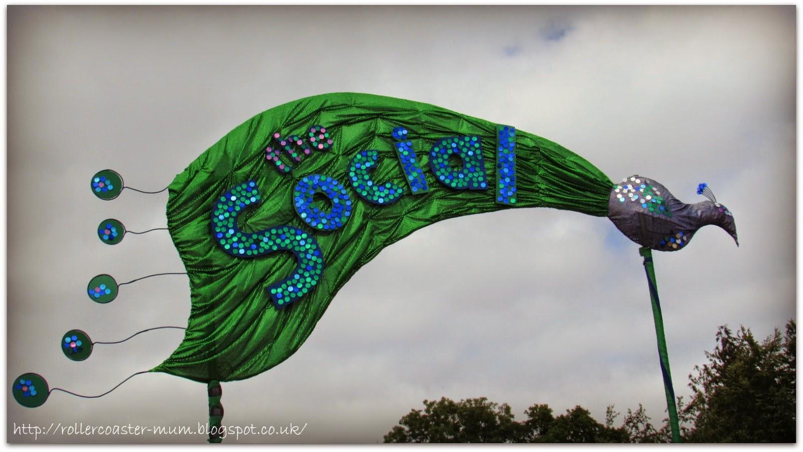 Peacock sign for the Social, Larmer Tree Festival