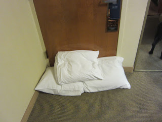 Photo of the three pillows stuffed at the foot of the door.