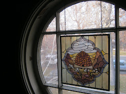 The Magical Round WIndow in the hall upstairs--now with a pioneer beehive and sego lilies . . .