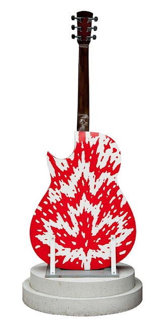 outdoor art display in downtown Orillia, painted guitars by local artists, this one with a red and white maple leaf design