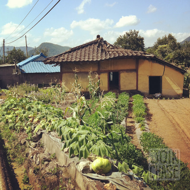 An old building and small farm in rural South Korea.