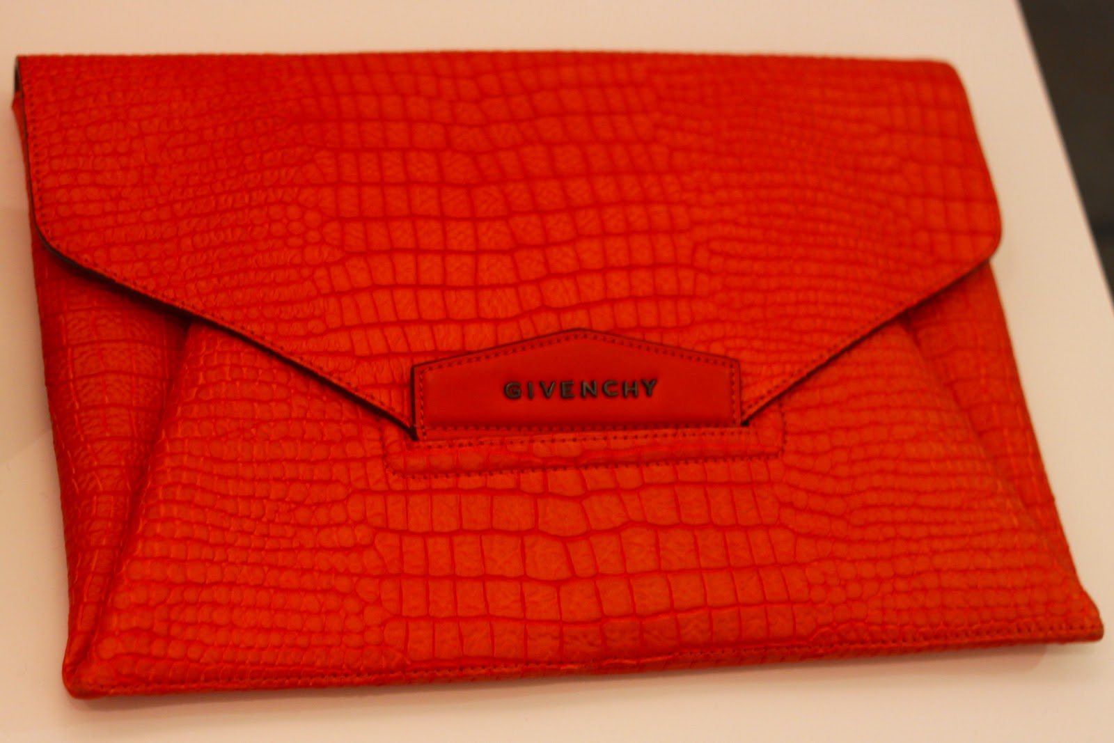 Givenchy orange snakeskin clutch bag