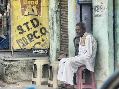 Man sitting out of the shop in Gujarat