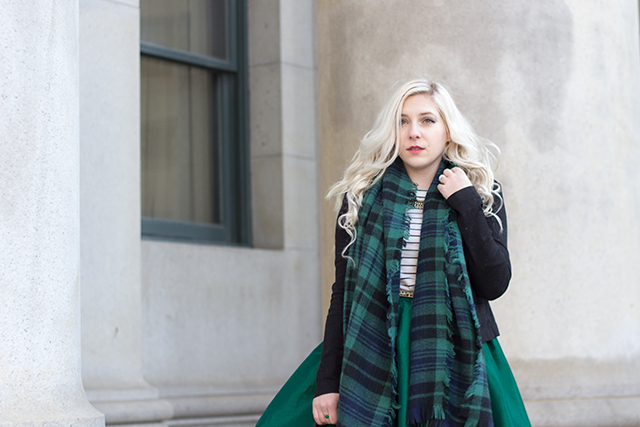 Emerald green midi skirt with a plaid blanket scarf, quilted Michael Kors bag, suede ankle boots a striped shirt and a military inspired jacket.