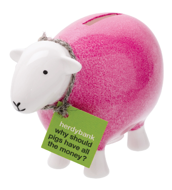 pink piggy bank shaped like a sheep