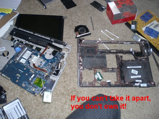 a picture of a disassembled laptop with red text reading if you can't take it apart, you don't own it