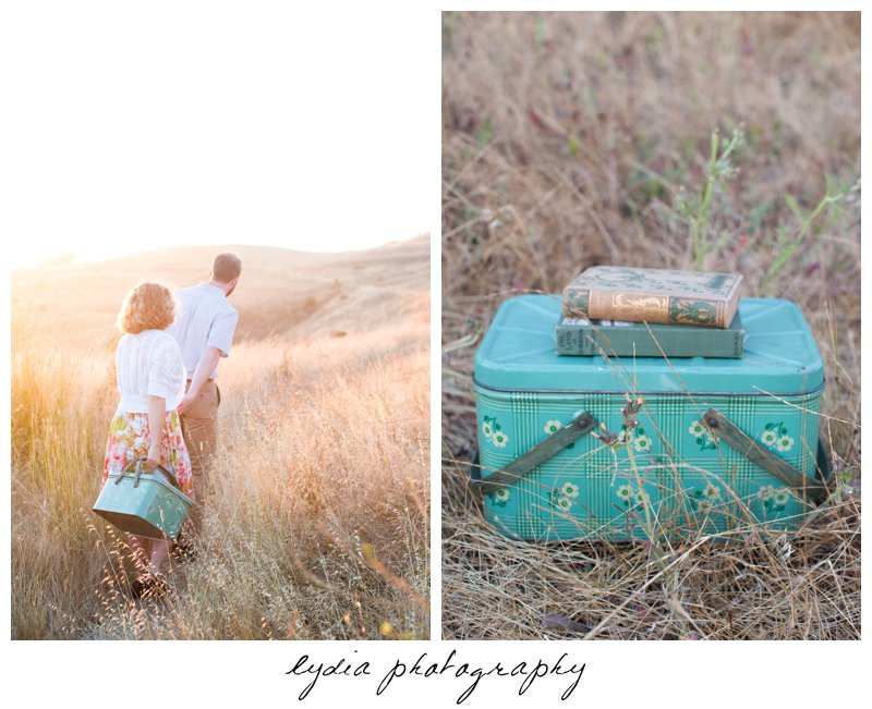 Books on top of picnic basket and bride and groom walking at lifestyle engagement portraits in the Bay Area of California