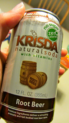 Krisda root beer being held in a hand