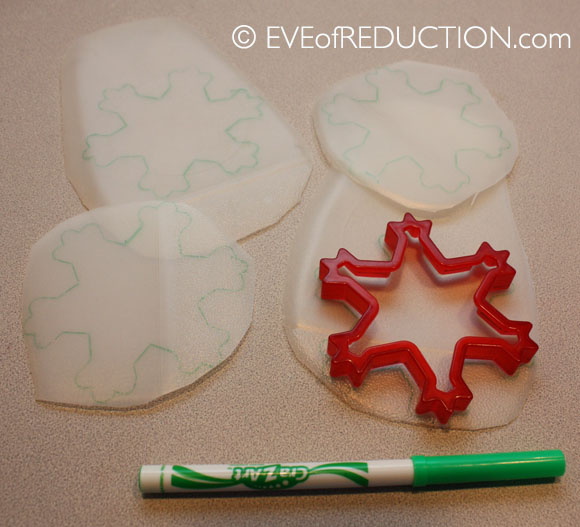 Recycled craft how to make milk jug snowflakes eve of for Christmas crafts with milk jugs