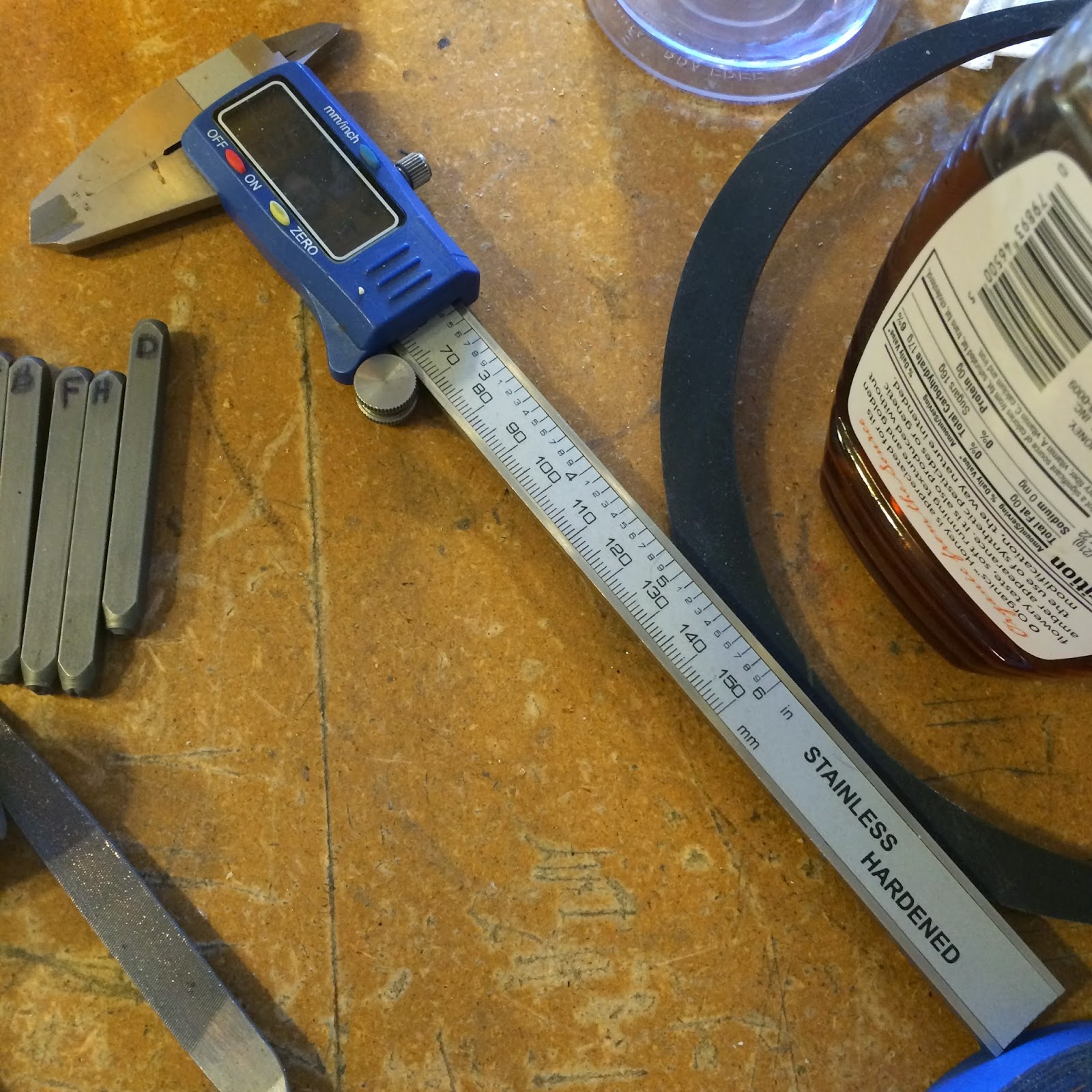 Calipers to measure and center saying