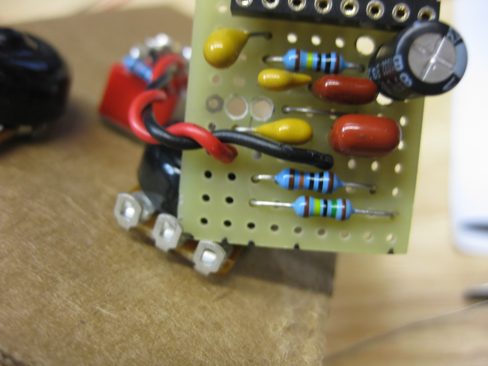 DIY Guitar pedal projects: Red Llama with mods is being soldered