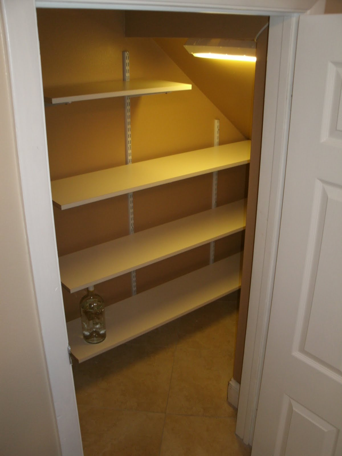 New Shelving In A Small Nook Under Stairs