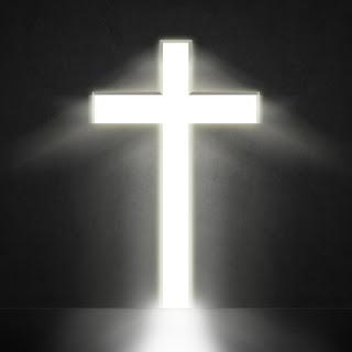 blazing white cross against a dark background