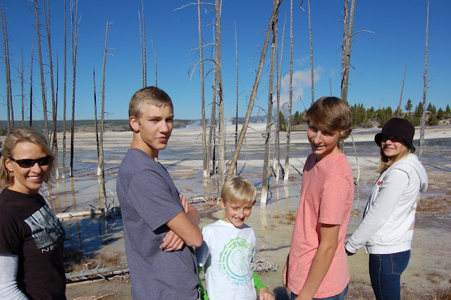 The family standing near the Lower Geyser Basin