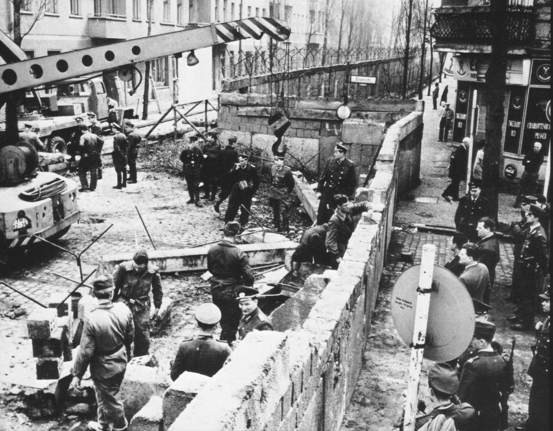 How did the USSR justify the Berlin Wall to its own population and world in general?