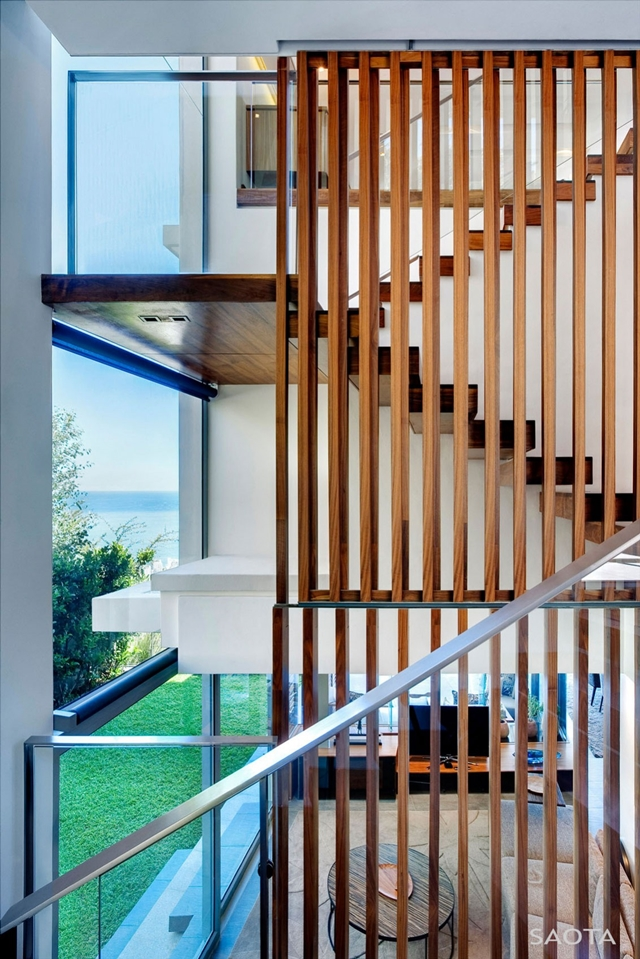 Wooden railing on the staircase