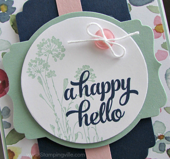 Wildflowers from Serene Silhouettes stamp set behind hello greeting from Tin of Cards stamp set on die-cut Deco Labels layering shape.