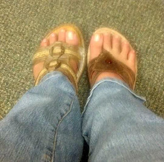 Wearing mismatched sandals.