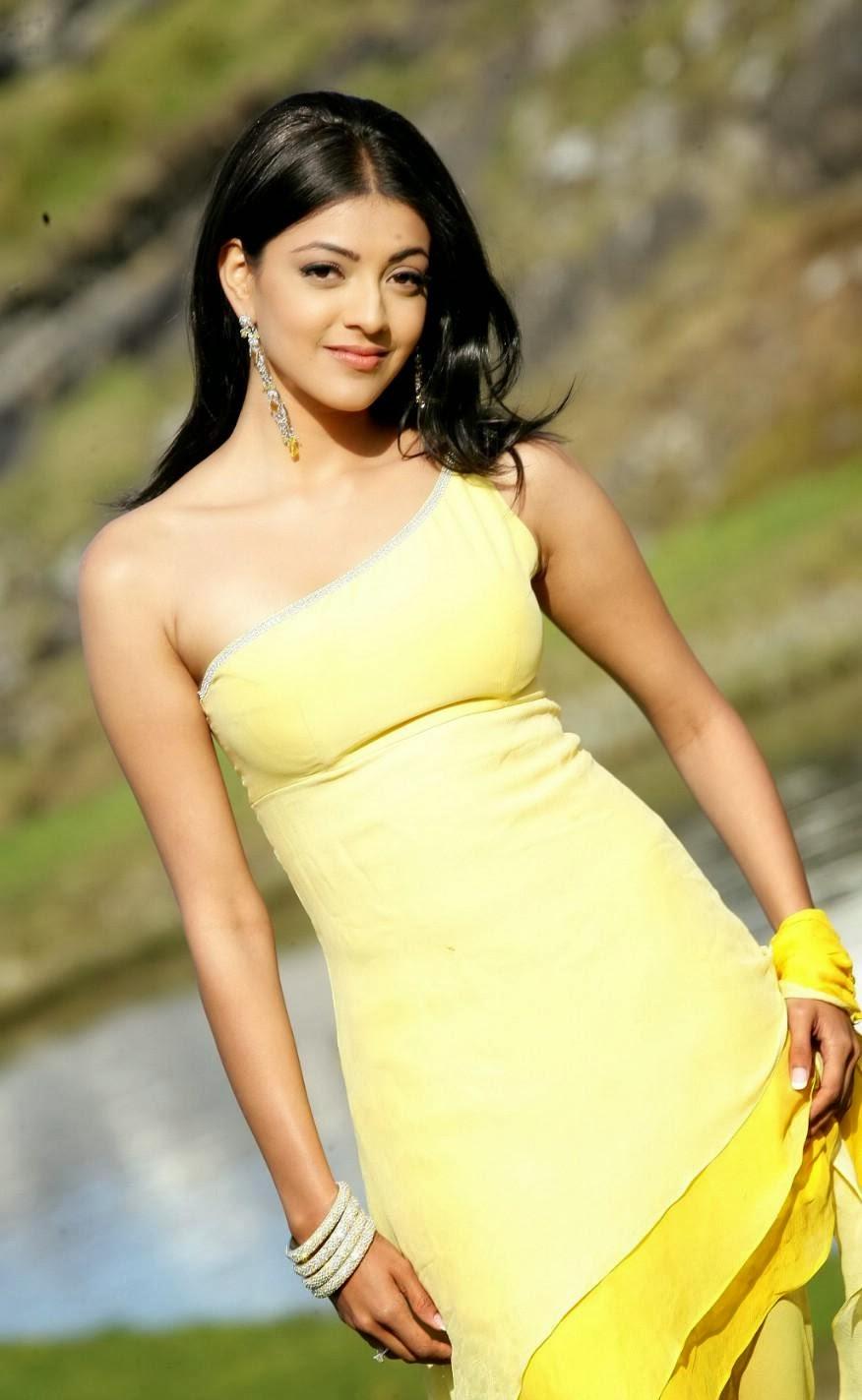 Kajal+Agarwal+Photos+in+Yellow+Dress004