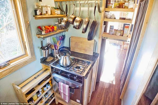 Slide-out drawers hide pantry shelves and spices.